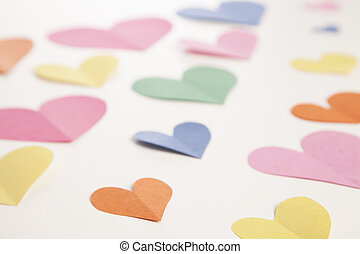 Paper Heart Background - Colorful paper hearts are cut out...