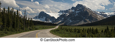 Highway passing below mountains - Highway passing below the...
