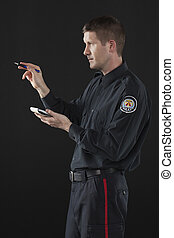 police man pointing while holding notebook