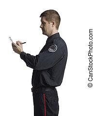 policeman noting something - Policeman noting something on...
