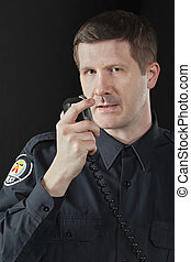 policeman talking on the cb phone - Close-up image of a...