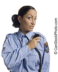 policewoman with radio - Mid-adult policewoman holding a...