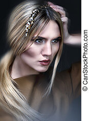 Studio shot of beautiful woman with a luxurious makeup and...