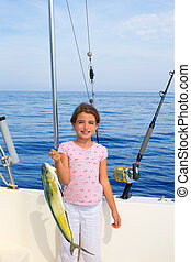 child girl fishing in boat with mahi mahi dorado fish catch...