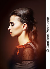 woman with a luxurious hairstyle and professional makeup -...