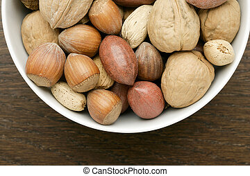 a bowl of hazelnuts - Cropped image of a bowl with hazelnuts...