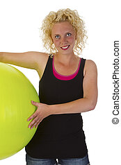 Beautiful young woman with gym ball - isolated on white...