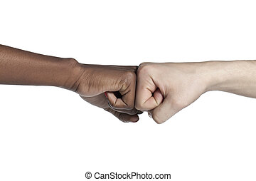 fist bumping - Close-up image of a human hand with a fist...