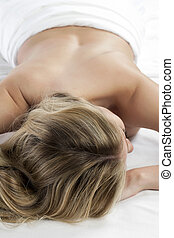 half naked woman lying in bed