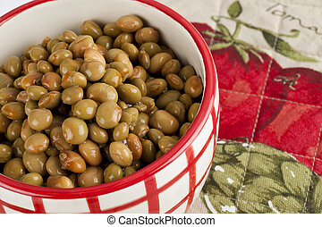 a bowl of cooked beans - Cropped image of a bowl with cooked...