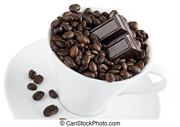 a cup of coffee beans with chocolate