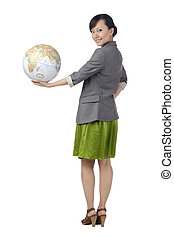 a woman holding the globe in hand