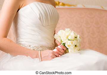 Bridal Bouquet - Bride holds bridal bouquet, pink couch on...