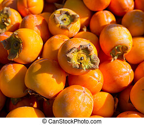 Persimmon ripe fruits pattern in market display