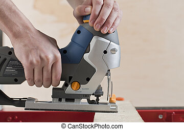 carpenter cutting wood