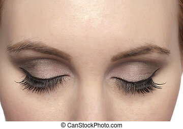 close eyes of a woman - Close up image of close eyes of a...