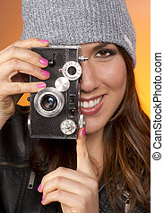 Woman Looks Right at the Camera taking a picture too