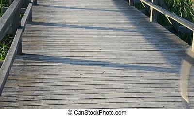 senior man bicycle bridge