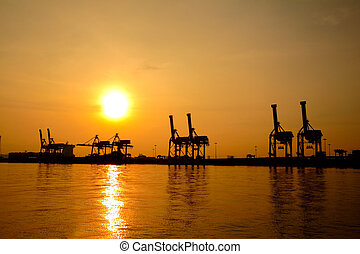 Container cargo freight ship silhouette in the morning, at...