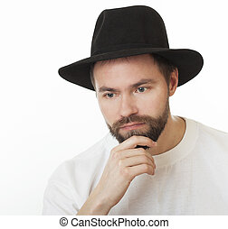 Man with a beard in the Jewish hat kneych.