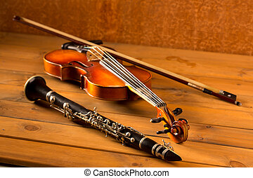Classic music violin and clarinet in vintage wood background