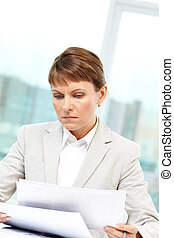 Paperwork - Photo of smart businesswoman working with papers...