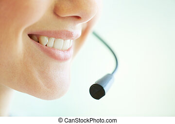 Telemarketing - Smiling telemarketing operator giving a...