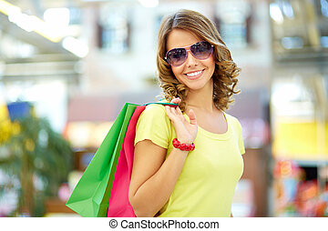 Summer shopper - Portrait of a shopping young woman wearing...