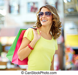 Carefree buyer - Cool shopping girl enjoying a carefree...