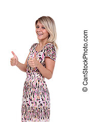 woman dressed in red is showing thumb up gesture using both...