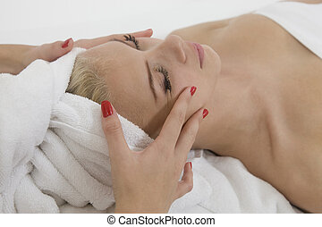 young woman getting massage from female hands on isolated...