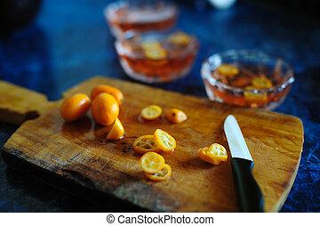Kumquat - An image of kumquat on a kitchen board