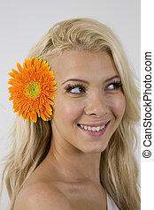woman with orange gerbera