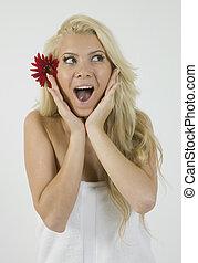 shocked female and gerbera in hair