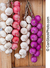 hanging onions  - Onions hanging on a door frame.
