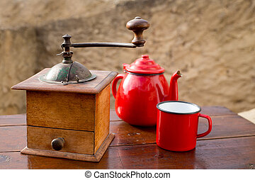 retro old coffee grinder with vintage red teapot - retro old...