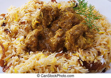 Hyderabadi biryani on white plate Garnished chicken biryani...