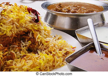 Yogurt and chicken curry with biryani - Yogurt, and chicken...