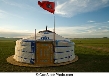 Mongolian ger with flag - A Mongolian ger in a field This is...