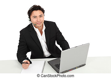 How can I help you - Young man working, with a laptop and...