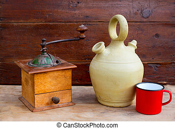 retro old coffee grinder and botijo in vintage wood - retro...
