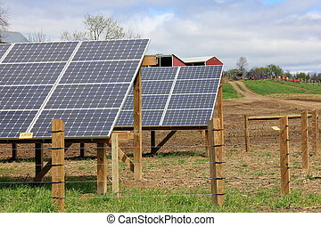 Rows of solar panels on farm - Rows of solar panels...
