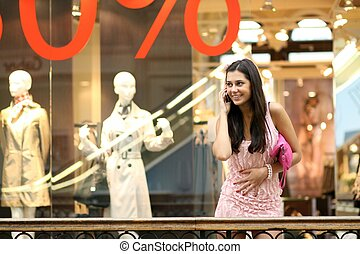 girl in shop calls by phone?
