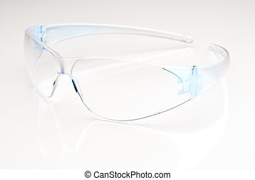 Safety glasses - Modern safetly glasses on a reflective...