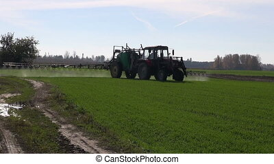 farmer tractor spraying crop - farmer tractor spraying with...