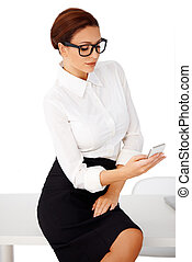 Businesswoman reading a text message - Attractive stylish...