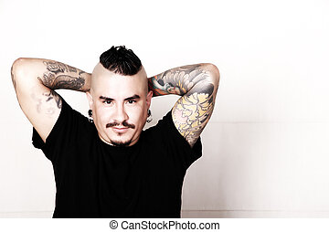 Confidence - Portrait of a tattooed relaxed, hispanic man