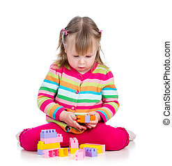 child playing  with colourful toys. Isolated on white background