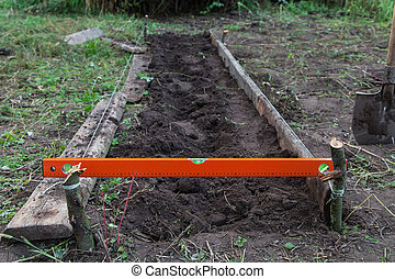 Excavation work on the farm, preparing beds for planting...