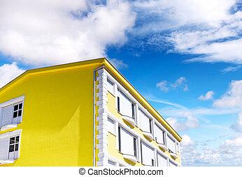 Sunny house on blue sky